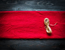 Red tablecloth on wooden background. Red tablecloth on old wooden background Royalty Free Stock Photos