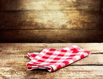 Red tablecloth on wooden background Royalty Free Stock Photos