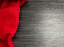Red tablecloth on wooden table for background. Fabric texture. Space for text. Red tablecloth on wooden table for background. Fabric texture. Wooden texture. Top Stock Image
