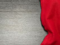Red tablecloth on wooden table for background. Top view. Space for text. Red tablecloth on wooden table for background. Fabric texture. Wooden texture. Top view Stock Images
