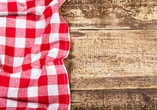 Red tablecloth on wooden table Stock Photography