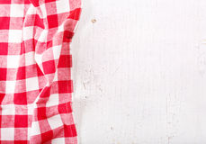 Red tablecloth on wooden table Stock Photo