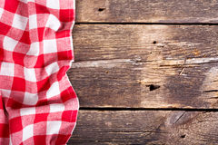 Red tablecloth on wooden table Stock Images