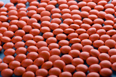 Red Tablet on blue closeup Stock Photography