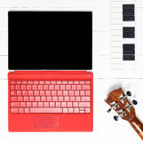 Red Tablet Computer Music Making. Techonology Royalty Free Stock Image