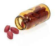Red tablets, bottle Royalty Free Stock Image