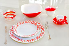 Red tableware. Love tableware with red hearts at glass table Royalty Free Stock Image