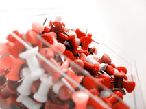 Red Tacks. Red themed thumbtacks in a clear plastic cube holder stock photo