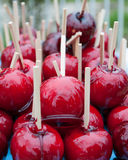 Candid apples. Red taffy apples covered with sugar on a stick Royalty Free Stock Photo