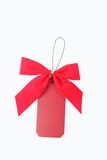 Red tag and bow Stock Images