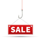 Red tag of sales, which hangs on a hook Stock Photo