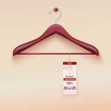 Red tag with special offer sign, wooden hanger Stock Image