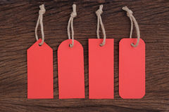 4 Red tags on Wood table for text and promotion Stock Image