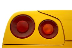 Red tail light on a yellow background. The photo was made by D200 at an exhibition of exotic automobiles stock photos
