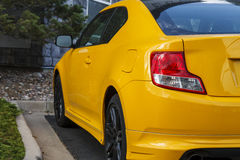 Red Taillight on Bright Yellow Car Royalty Free Stock Photography