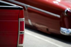 Red taillights o fared truck and red classic car Royalty Free Stock Photo