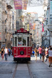 Red Taksim Tunel Nostalgic Tram on the istiklal street. Istanbul, Turkey. ISTANBUL, TURKEY - JULY 31, 2015 : The Taksim Tunel Nostalgia Tram trundles along the Stock Image