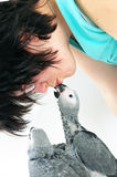 Red tale parrot on white kissing with female Royalty Free Stock Photos
