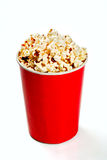 Red tall bowl with popcorn Stock Images