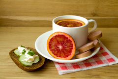 Red tangerine on a white plate. Royalty Free Stock Photography