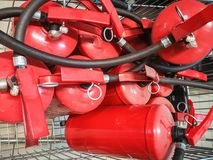 Red tank of fire extinguisher. Overview of a powerful industrial fire extinguishing system. Emergency equipment for industrial stock photos