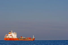 Red tanker, blue sea. And blue sky Royalty Free Stock Image