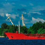 Red tanker ship. Red cargo tanker ship moving by the river Royalty Free Stock Image