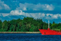 Red tanker ship. Red cargo tanker ship moving by the river Stock Photo