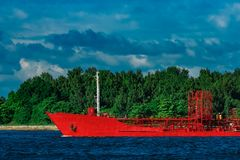 Red tanker ship. Red cargo tanker ship moving by the river Stock Image