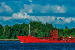 Red tanker ship. Red cargo tanker ship moving by the river Royalty Free Stock Images