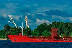 Red tanker ship. Red cargo tanker ship moving by the river Stock Photography