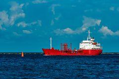 Red tanker ship. Red cargo tanker ship moving by the river Royalty Free Stock Photo