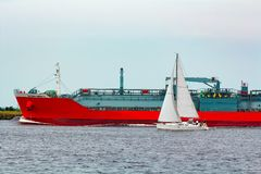Red cargo tanker ship. Red tanker. Toxic substances and petroleum products transfer Royalty Free Stock Photography