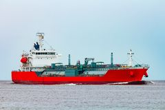 Red cargo tanker ship. Red tanker. Toxic substances and petroleum products transfer Stock Images