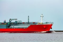 Red cargo tanker ship. Red tanker. Toxic substances and petroleum products transfer Royalty Free Stock Images