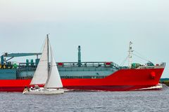 Red cargo tanker ship. Red tanker. Toxic substances and petroleum products transfer Stock Photo