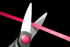 Red tape going to be cutted by scissors Stock Images