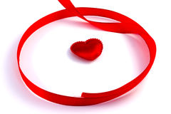 Red tape loop with small heart. On a white background Royalty Free Stock Images