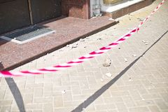 Red tape overlap by police entrance, building collapse, incident, ruin, news, stones on road. Red tape overlap by police entrance, building collapse, incident stock photos