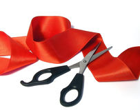 Red tape and scissors Stock Photo