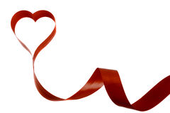Red tape on a white background in the form of heart. On a white background a red ribbon in the form of heart royalty free stock images