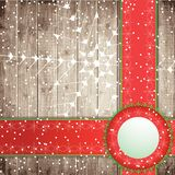 Red tapes and snowflakes on the wooden board background. Stock Photo