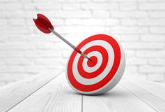 Red target dart. Strategic business solutions or corporate strategy concept: digital generated dart in the center of a red target, modern wooden and bricks stock illustration