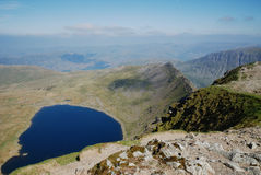 Red tarn. Is that a face! - Red Tarn Royalty Free Stock Photos