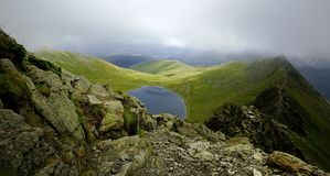 Red Tarn and Birkhouse Moor. Sunllight on Birkhouse Moor  from Striding Edge Royalty Free Stock Photos