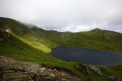 Red Tarn and Catseye Cam. Low Clouds over the summit of Helvellyn Royalty Free Stock Photography