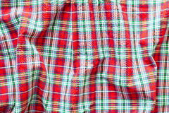 Red tartan. Crumpled red tartan cotton material as a background Stock Photography