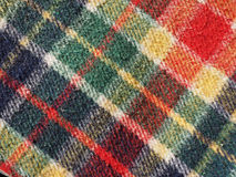 Red tartan background. Red green blue and yellow tartan fabric useful as a background Stock Images