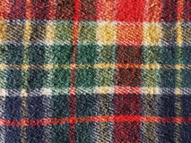 Red tartan background. Red green blue and yellow tartan fabric useful as a background Royalty Free Stock Images