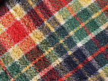 Red tartan background. Red green blue and yellow tartan fabric useful as a background Stock Photo